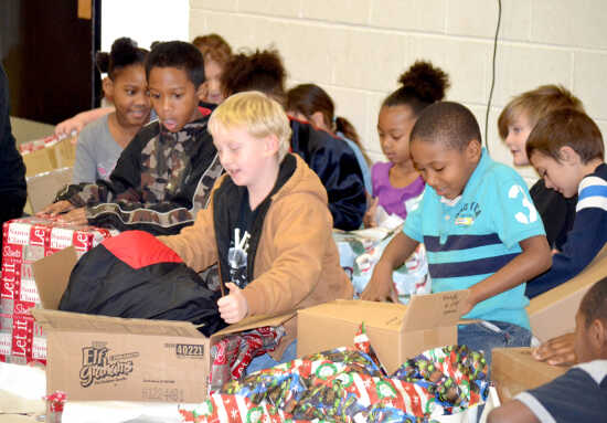 Bus drivers deliver coats to students