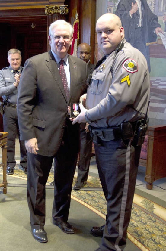 Scott County deputy gets Medal of Valor from Gov. Nixon