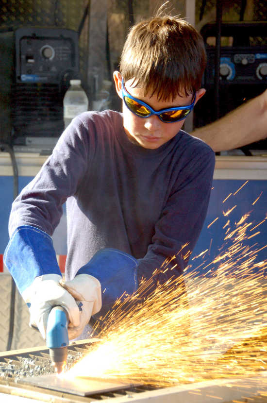Forging new skills: Merit badge camp introduces Boy Scouts to metal work