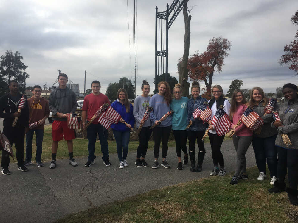 FBLA Students putting out Flags at Cemetery