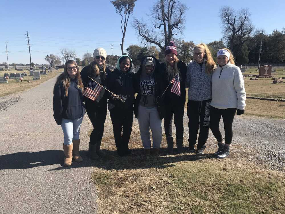 FBLA putting flags at cemetery
